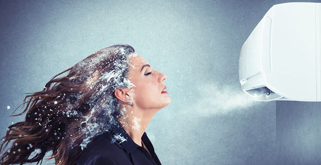 air conditioning unit blowing ice cold air on woman